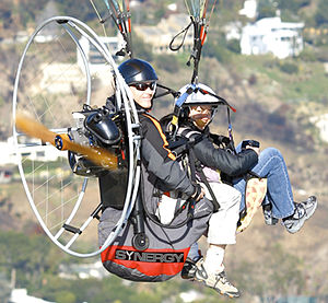 flying a paraglider tandem with the Synergy pa...